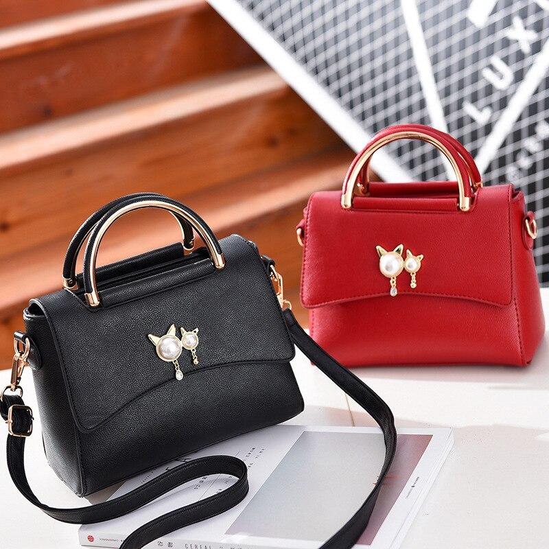 Sac de luxe femmes perle chat suspendu sac à main en métal poignée qualité sacs à bandoulière dames élégant sacoche en cuir synthétique polyuréthane Bolsa