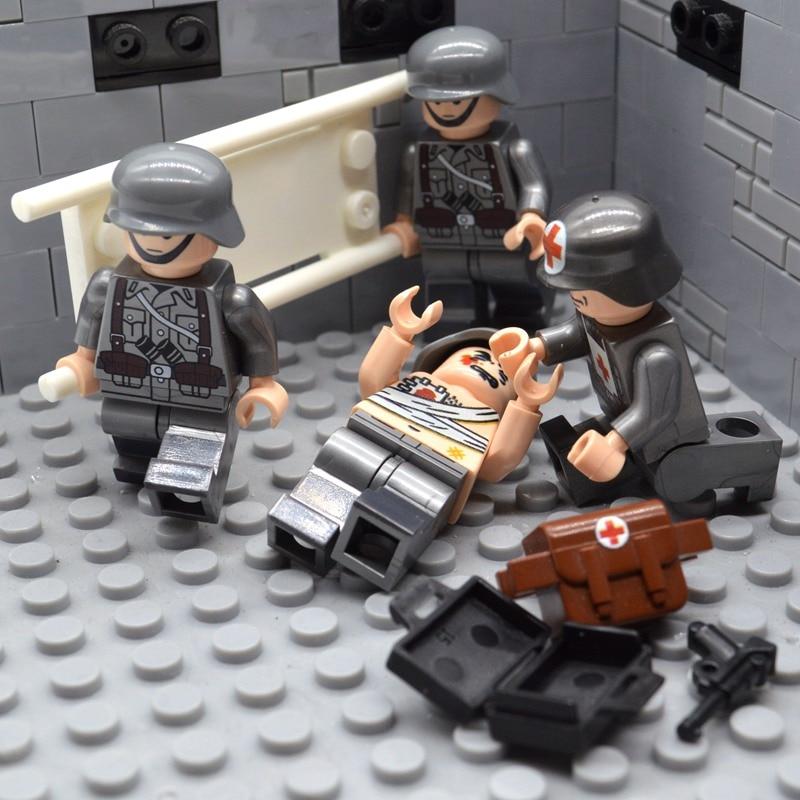 4 teile/satz Ziegel WW2 Soldat Deutsch Sanitäter Team MOC UV-Druck Behandlung Verletzt Bausteine Spielzeug für Kinder