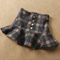 Inglaterra estilo de cachemira 2016 nueva llegada imperio bud faldas lolita sweet retro plaid falda faldas minifalda primavera invierno de las mujeres