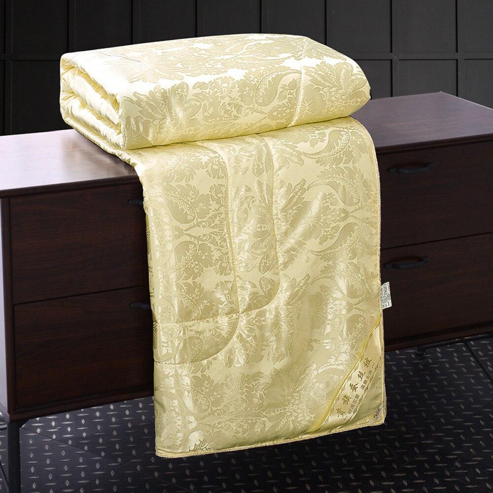 Quatre couleurs soie du mûrier couette couvre-lits matelassés couverture d'été et d'hiver roi reine pleine taille double couette literie ensemble