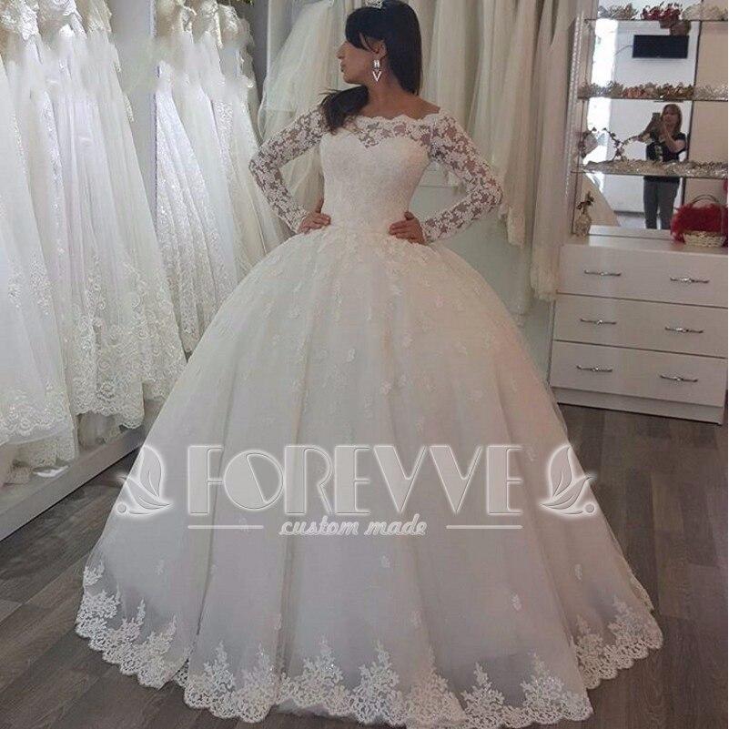 Vestido de novia corte princesa con olanes