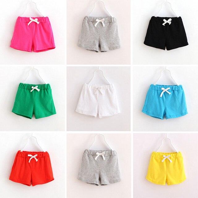 Verano moda niños pantalones cortos deportes del color del caramelo ...