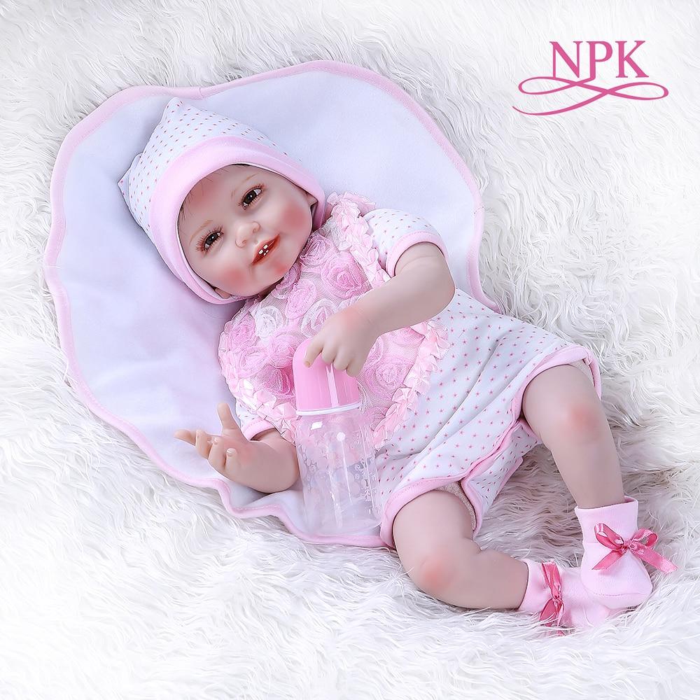 Npk55cm 0 3 개월 진짜 아기 크기 미소 아기 치아 다시 태어난 아기 인형 살아있는 부드러운 터치 가중 바디 인형 핑크 드레스-에서인형부터 완구 & 취미 의  그룹 1