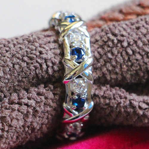 Genuino 925 T marca personalizada NSCD sintético diamante zafiro banda infinito anillo de plata 925 mujeres joyería anillo de la eternidad de la boda