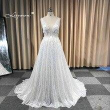 فستان زفاف من Leeymon2020 مصنوع حسب الطلب مثير ساحر على شكل حرف a مزين بالدانتيل بدون ظهر فستان زفاف عاجي