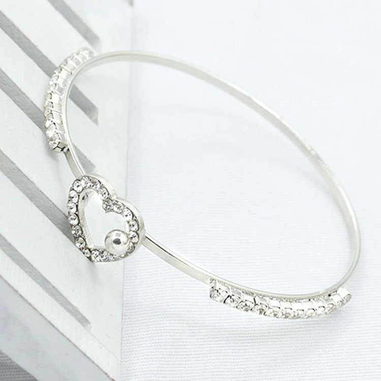 Nueva joyería de moda de una sola fila de diamantes de imitación de cristal de ópalo lazos amor corazón pulsera brazaletes