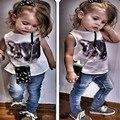 Мода летней девушки 2 шт. костюм кошки печать жилет + джинсы комплект одежды европейский и американский стиль 2015 детей удовлетворить девушки наряды