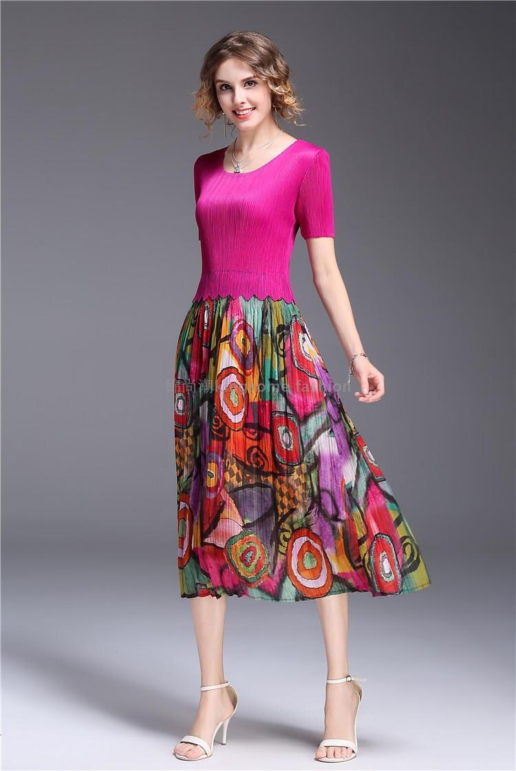 Livraison gratuite Miyake pli robe élastique net fil épissage dentelle robe avec manches courtes en STOCK