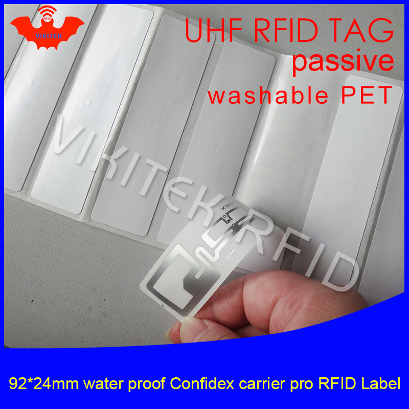 UHF RFID tag confidex carrier Pro washable printable PET label 915m 92*24mm 868m 860-960M EPC 6C waterproof passive RFID label 100pcs washable silica gel uhf high temperature resistant rfid clothing tag used for clothes management and laundry shop