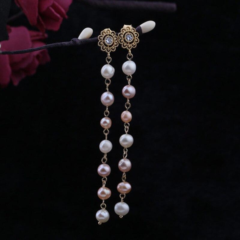 Boucles d'oreilles longues en perles incrustées de perles