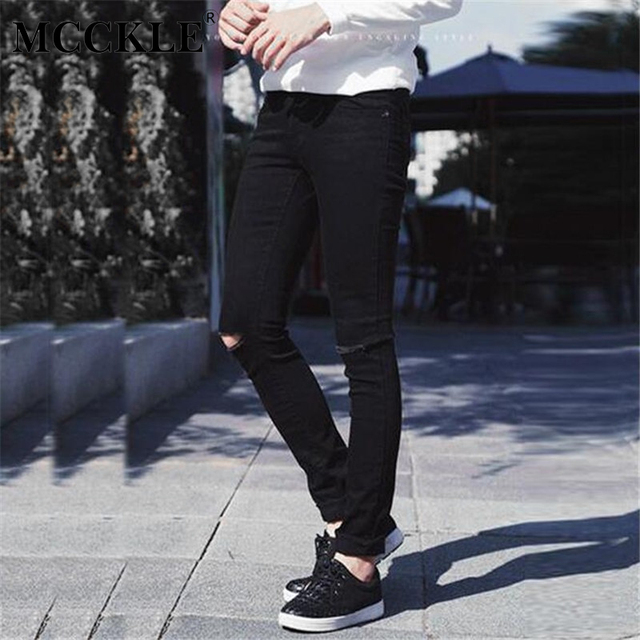 Black skinny jeans with holes in knees