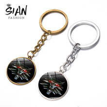 SIAN The Witcher 3 Wild Hunt Medallion Keychain Red Eyes Wolf Head Magic Animal 3D Printed Charm Key Chain Alloy Key Ring Holder(China)
