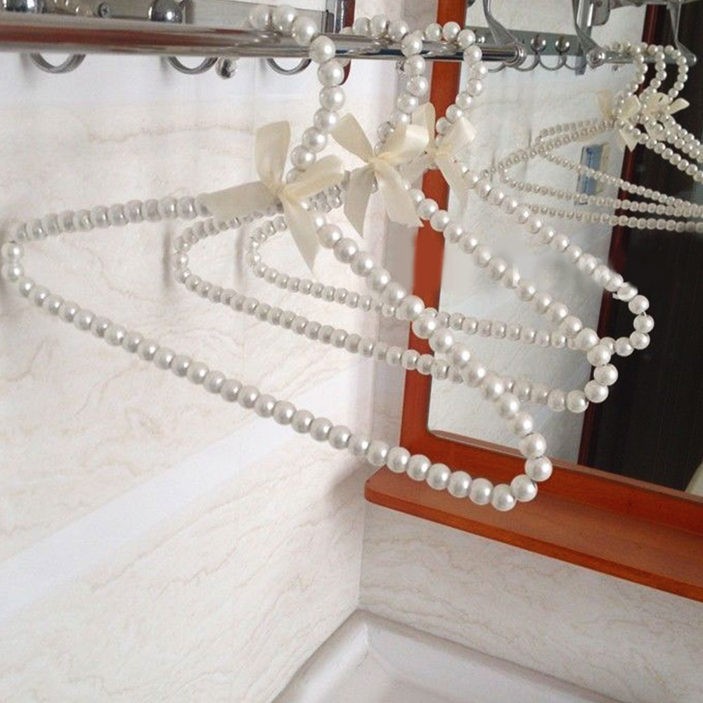 1 Pcs Clothes Hanger Plastic Pearl Beaded Bow Clothes Dress Coat Hangers Closet wieszak perchas Coat Storage Organizer Dry Rack|Hangers & Racks| |  - title=