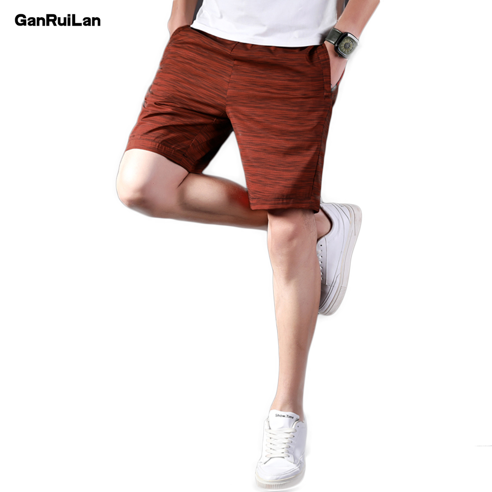2018 New Mens Solid Loose Shorts Casual Cargo Short Pants Camouflage Short Trousers Man Loose Casual Shorts Bermuda DK18015