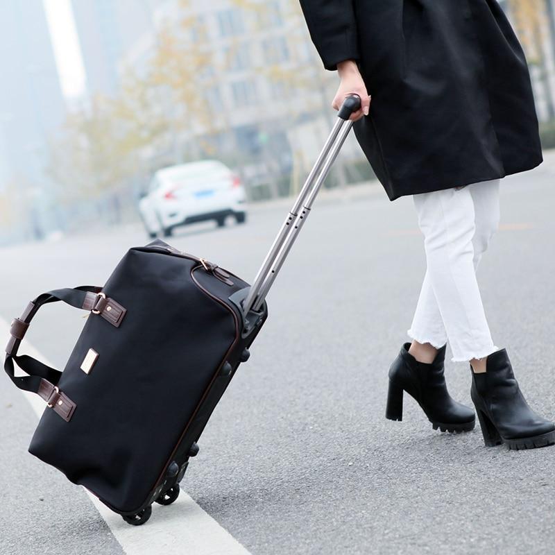 Di modo Unisex Borse Da Viaggio Bagaglio Ruote Dei Bagagli del Duffle Borsa Pieghevole Grande Capacità Trolley Bag Clothes Organizer Tote Bag Rimorchiatore