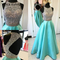 Luxury Beaded Sequins Turquoise Prom Dresses 2018 Halter Sleeveless A Line Satin Sexy Open Back Pageant Gala Dress Long Gowns