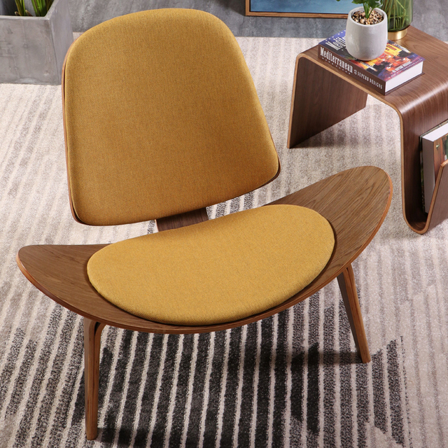 fabric living room chairs furniture layout for small narrow hans wegner style three legged shell chair plywood linen seat cushion modern lounge
