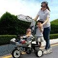 Los niños triciclo bebé doble Niños de paseo en bicicleta