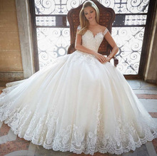 New Cap Sleeves Appliques Lace Dresses for Wedding Party 2019 Princess Bridal Gowns Sheer Buttons robe de mariee