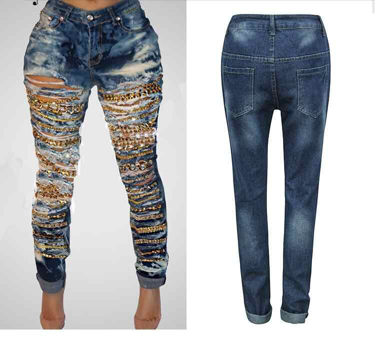 8792df9c603 New arrival retro hole chain denim ripped jeans femme fashion cool mid waist  plus size women