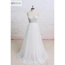 Weiß V ausschnitt Appliques Tüll Bodenlangen A linie Hochzeit kleid Ärmellose Echten/Original Fotos maß