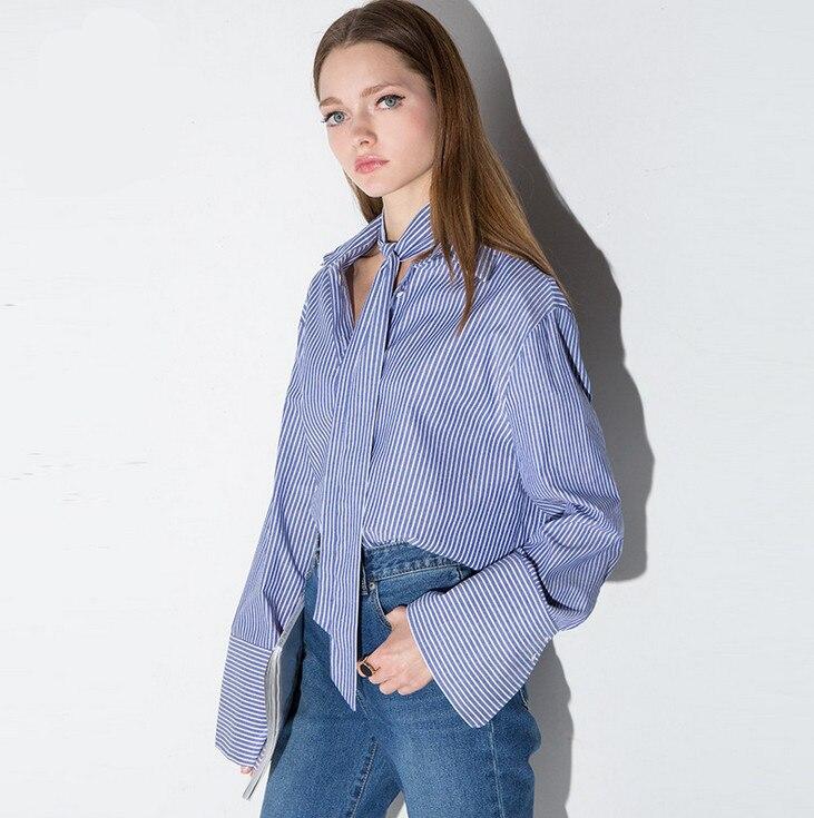 3865b52ef5 Vagary lapel rayas verticales Blusas estilo casual mujer Camisas nueva  llegada damas azul blanco manga larga corbata Masajeadores de cuello  Botones blusa