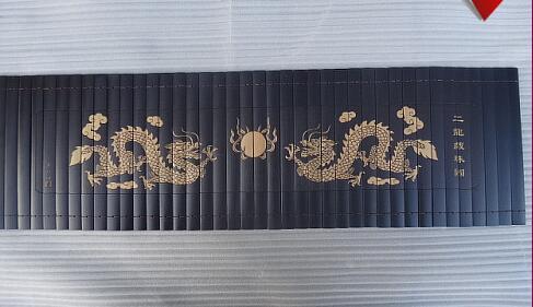 Bambou glisse des arts et métiers folkloriques calligraphie et peinture deux dragons jouent à la perle