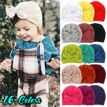 цены на Newborn Baby Cute Bowknot  Beanie Hat Toddler Kids Boy Girl Soft Cotton Warm Hat Knitted Cap Crochet Solid Headwear Accessories  в интернет-магазинах