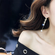 2018 New South Korea's simple wild flash ball tassel earrings round ear nail long temperament R Stud Earrings wholesale(China)