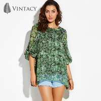 Vintacy Casual Shirt Women Green Back Hollow Out Lace Up Floral Blouse Ladies Transparent Lantern Sleeve