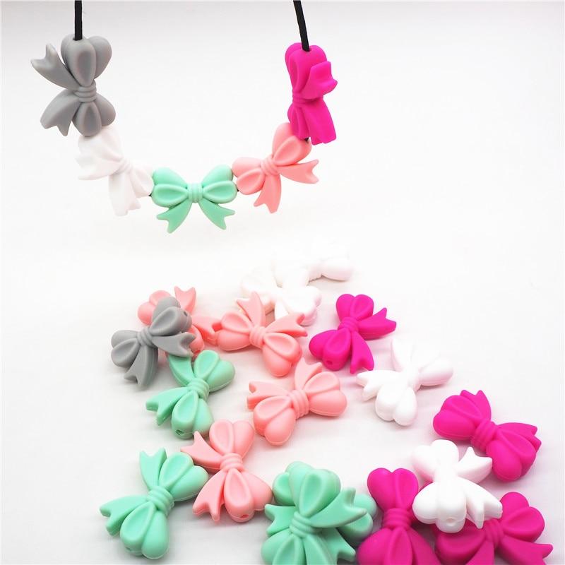 Купить с кэшбэком Chenkai 10pcs BPA Free Silicone Bow Tie Teether Beads DIY Baby Animal Teething Montessori Sensory Jewelry Toy Bow-Knot Bead