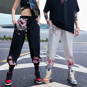 Image 1 - 2019 Fashion Design Crane Peach Flower Print Harlan Pants Men and Women Universal Leisure Sports Pants Skateboard Pants