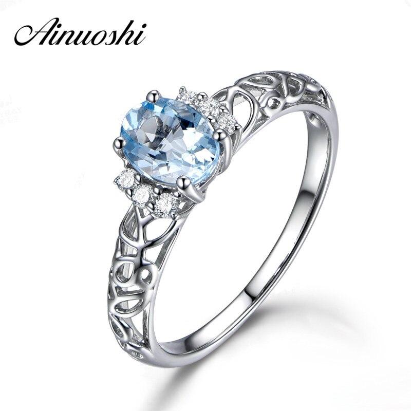 f5548e6de91e Ainuoshi 1.25ct oval natural cielo azul piedras pr Topaz anillo sólido 925  plata esterlina anillo hueco para las mujeres Amuletos joyería de la boda