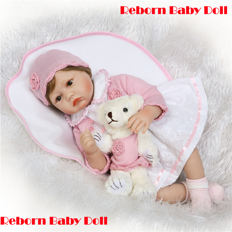 New 55cm silicone reborn dolls lifelike newborn babies toys with bear soft touch bebe toys reborn boneca de panoNew 55cm silicone reborn dolls lifelike newborn babies toys with bear soft touch bebe toys reborn boneca de pano