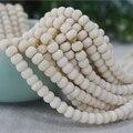 Nuevo 108 Unids Tagua Nut 7x5mm Ronda Plana Perlas Naturales Blanco Color De Madera Granos Flojos Para La Joyería Que Hace DIY Pulsera Del Encanto venta al por mayor