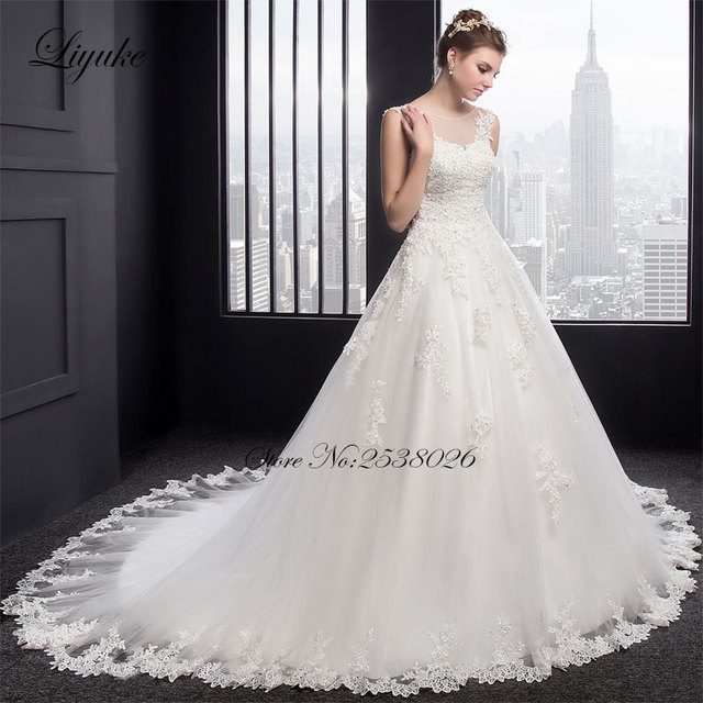 f4c78fc3242 Sheer Appliques Tulle Scoop A-Line Wedding Dress Court Train Sleeveless Lace  Up Beading Crystals Plus Size robe de mariage