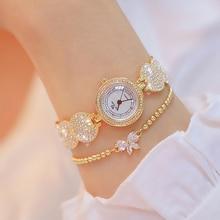 цена Gold New Design Fashion Women Watch Elegant Flower Bracelet Wristwatches Round Quartz Watch Luxury Brand BS онлайн в 2017 году