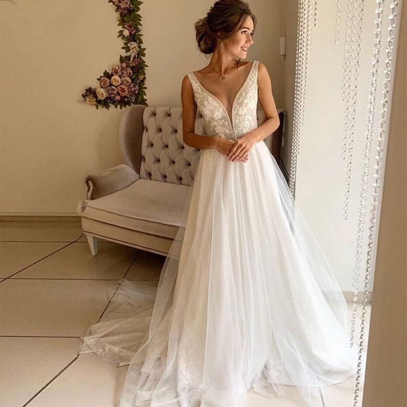 2019 Deep V-neck Wedding Dresses Appliques Beading White Ivory Bridal Dress Covered Buttons Sparkle Bling Long Robe De Mariee