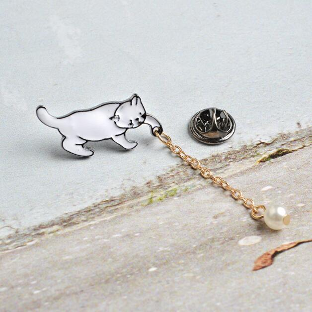 Little Cat with Pearl Brooch