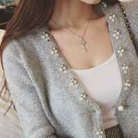 The European Station Hitz Korean Women S Sweater Long Sleeved Knit Cardigan Jacket Pocket Pearl Rhinestone