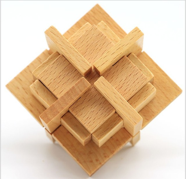 wooden burr puzzle with multiple layers. Looks like a square pyramid or Inca temple.