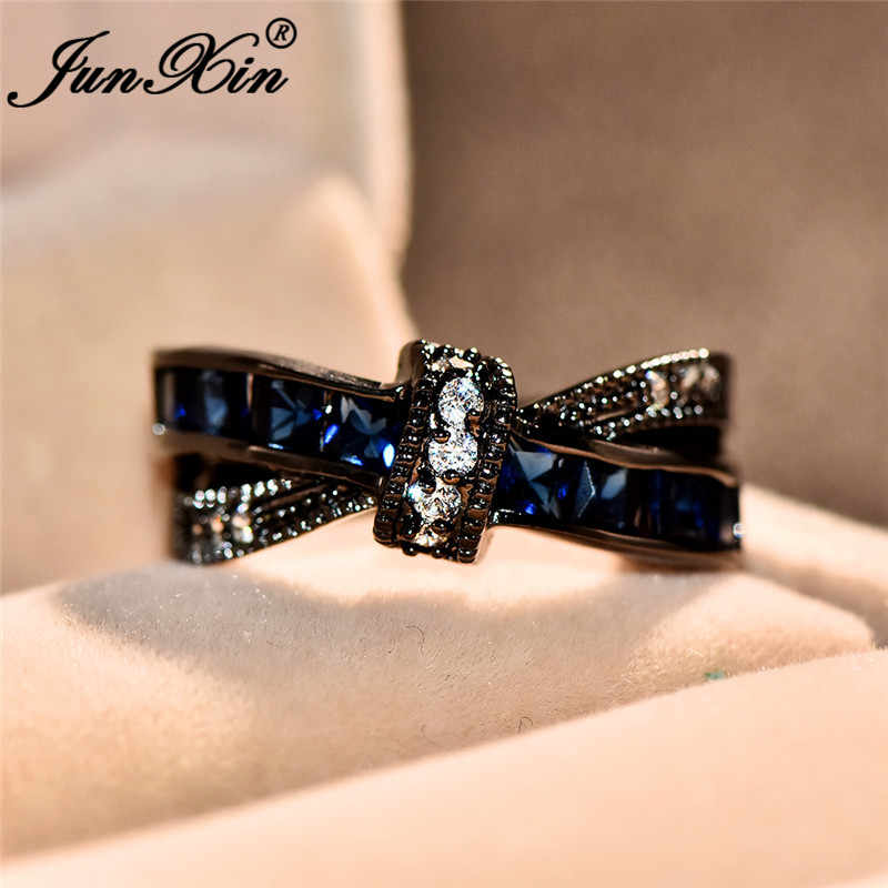 JUNXIN ขนาดเล็ก Square Blue Zircon Cross X แหวน Black Gold Filled คริสตัลแต่งงานแหวนหญิงกันยายน Birthstone แหวนของขวัญ