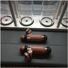 Inyector de combustible genuino, 550cc WRX, boquilla para combustible, color rosa, 195500-3910