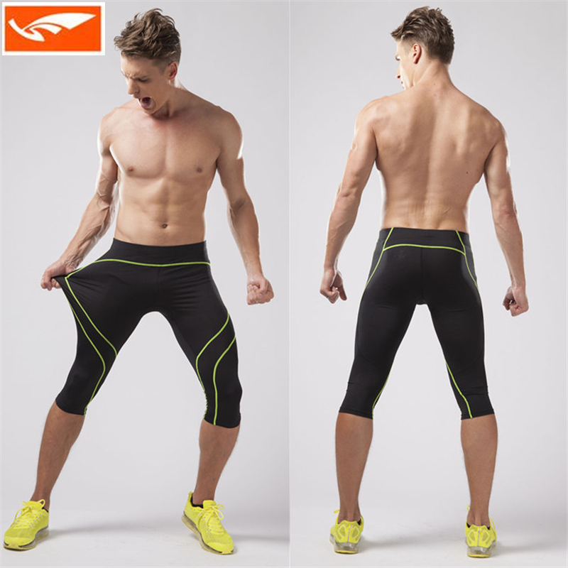 Compression running pants men 39 s men 39 s 3 4 jogging pants for Dress shirts for athletic guys