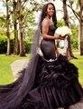 Único negro de la sirena vestidos de baile 2017 Sexy sin mangas vestidos de baile ruffles sirena Del Amor formal largo de noche vestidos de fiesta