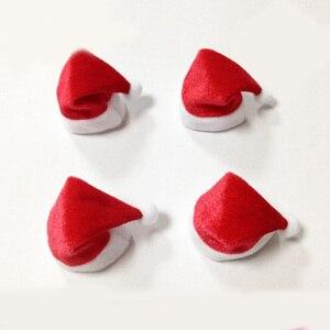 Image 2 - 10 unidades/juego de Mini sombrero de Navidad, gorro de Papá Noel, tapas de botella de vino de manzana, gorros de regalo de Navidad para decoración de árbol de Año Nuevo, ornamento para árbol