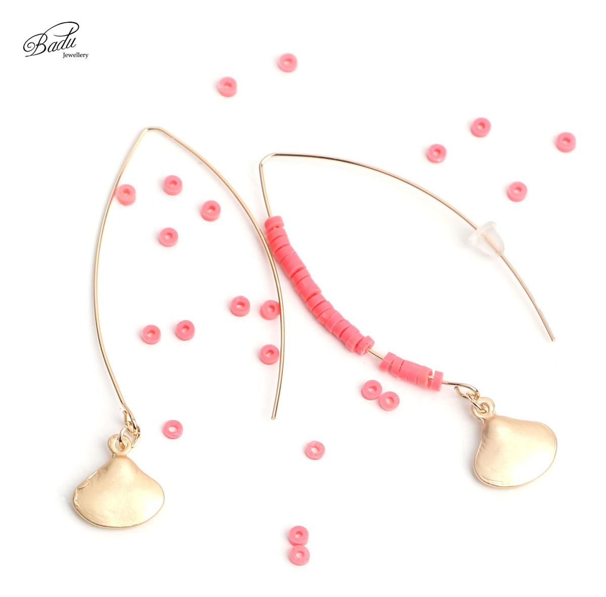5b75fb58b79e Badu las mujeres pendientes de oro Vieira largo colgante de joyería de moda  rojo granos de arcilla vacaciones de verano pendientes elegantes para boda  en ...