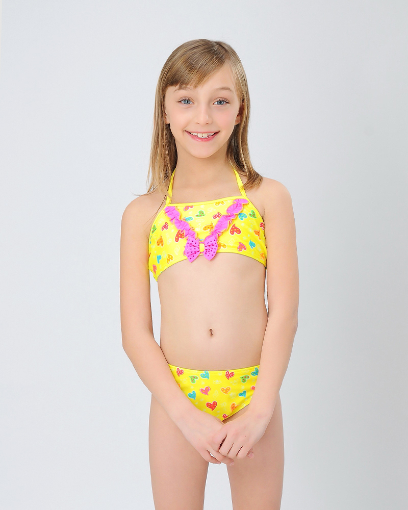 little girls' two piece swimwear Our selection of two piece bathing suits for little girls includes girls' bikinis and girls' tankinis in a variety of styles. Choose from sporty two piece styles, to bikinis and tankinis with ruffles and skirts.