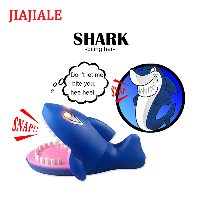 Interesting toy shark biting fingers were tricky practical joke parent-child interaction family childrens party for toys