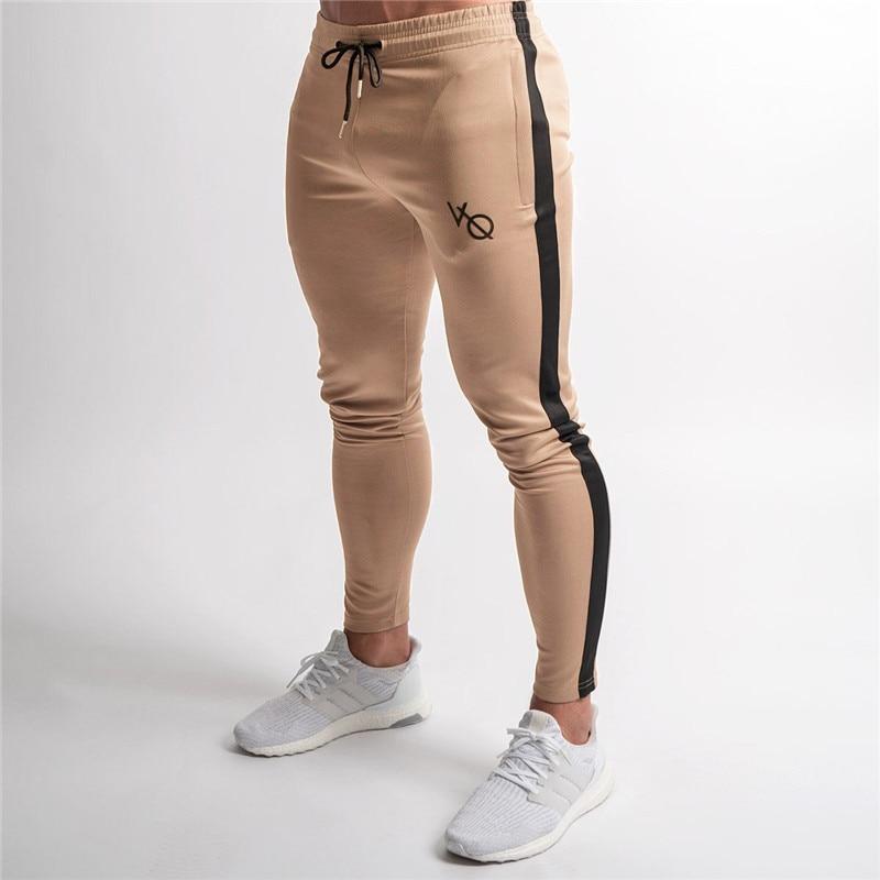 2018 elasticidad hombre Joggers pantalones casuales de moda de culturismo Joggers pantalones de fondo Patchwork pantalones hombres Pantalones Casual